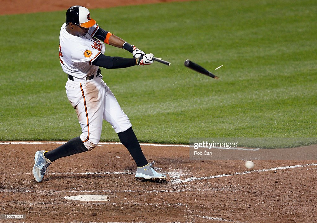 Adam Jones #10 of the Baltimore Orioles breaks his bat while grounding out for the last out of the seventh inning against the Tampa Bay Rays at Oriole Park at Camden Yards on April 16, 2013 in Baltimore, Maryland.