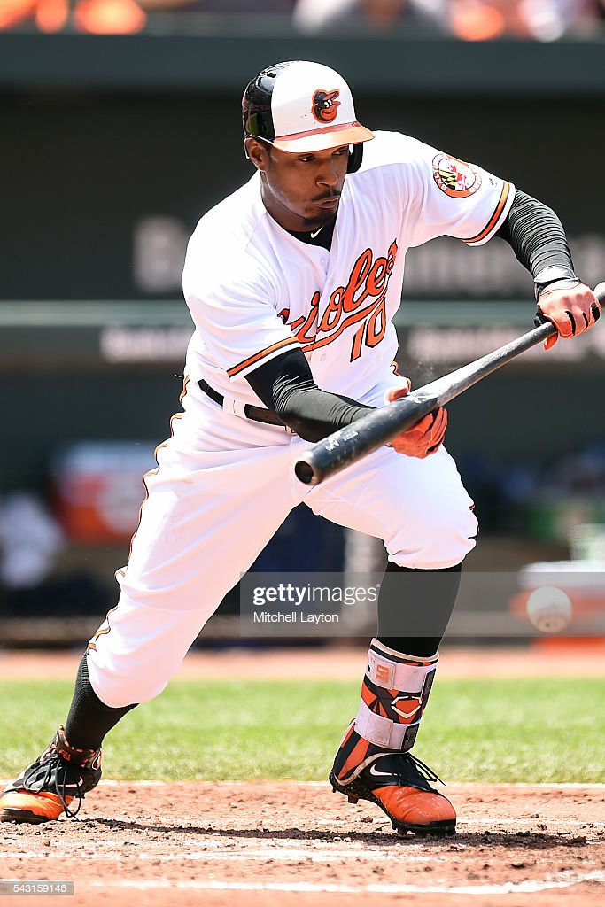 <a gi-track='captionPersonalityLinkClicked' href=/galleries/search?phrase=Adam+Jones+-+Baseball+Player&family=editorial&specificpeople=5460465 ng-click='$event.stopPropagation()'>Adam Jones</a> #10 of the Baltimore Orioles bun singles Joey Rickard #23 (not pictured) home in the second innings during a baseball game against the Tampa Bay Rays at Oriole Park at Camden Yards on June 26, 2016 in Baltimore, Maryland.