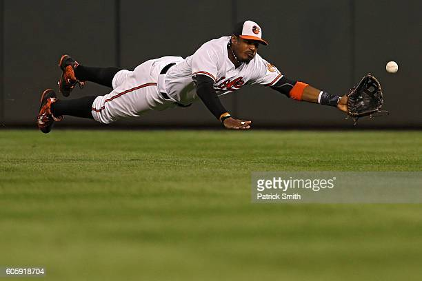 Adam Jones of the Baltimore Orioles cannot make a catch on an RBI double hit by Steven Souza Jr #20 of the Tampa Bay Rays during the third inning at...