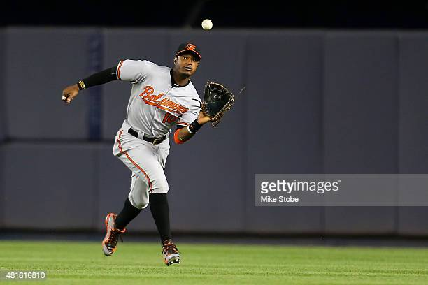 Adam Jones of the Baltimore Orioles catches a fly ball off the bat of Jacoby Ellsbury of the New York Yankees in the seventh inning at Yankee Stadium...