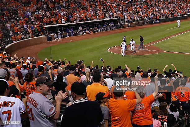 Adam Jones of the Baltimore Orioles celebrates with Delmon Young after hitting a home run against the Toronto Blue Jays at Oriole Park at Camden...