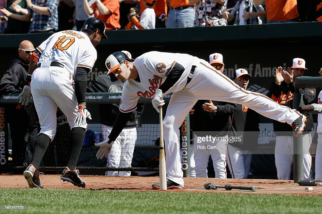 Adam Jones #10 of the Baltimore Orioles celebrates with <a gi-track='captionPersonalityLinkClicked' href=/galleries/search?phrase=Matt+Wieters&family=editorial&specificpeople=4498276 ng-click='$event.stopPropagation()'>Matt Wieters</a> #32 after hitting a solo home run against the Los Angeles Dodgers during the third inning at Oriole Park at Camden Yards on April 21, 2013 in Baltimore, Maryland.