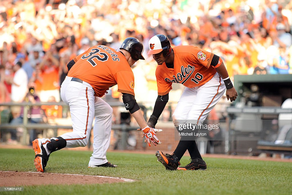 Adam Jones #10 of the Baltimore Orioles congratulates teammate <a gi-track='captionPersonalityLinkClicked' href=/galleries/search?phrase=Matt+Wieters&family=editorial&specificpeople=4498276 ng-click='$event.stopPropagation()'>Matt Wieters</a> #32 on a two-run home run in the ninth inning during a baseball game against the Boston Red Sox on June 15, 2013 at Oriole Park at Camden Yards in Baltimore, Maryland.
