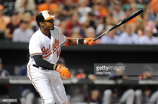 Adam Jones of the Baltimore Orioles drives in a run with a double in the seventh inning against the Boston Red Sox at Oriole Park at Camden Yards on...