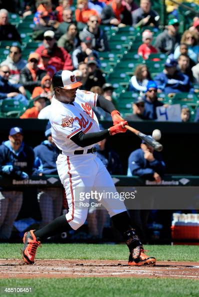 Adam Jones of the Baltimore Orioles fouls off a pitch against the Tampa Bay Rays at Oriole Park at Camden Yards on April 16 2014 in Baltimore...