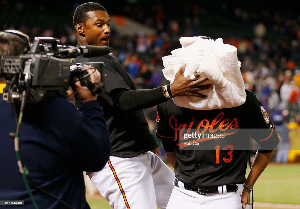 Adam Jones #10 of the Baltimore Orioles hits <a gi-track='captionPersonalityLinkClicked' href=/galleries/search?phrase=Manny+Machado&family=editorial&specificpeople=5591039 ng-click='$event.stopPropagation()'>Manny Machado</a> #13 with a shaving cream pie following the Orioles 6-1 win over the Los Angeles Dodgers during game two of a double header at Oriole Park at Camden Yards on April 20, 2013 in Baltimore, Maryland.