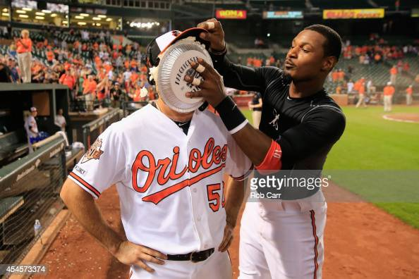 Adam Jones of the Baltimore Orioles hits starting pitcher Miguel Gonzalez in the face with a pie following the Orioles 60 win over the Cincinnati...