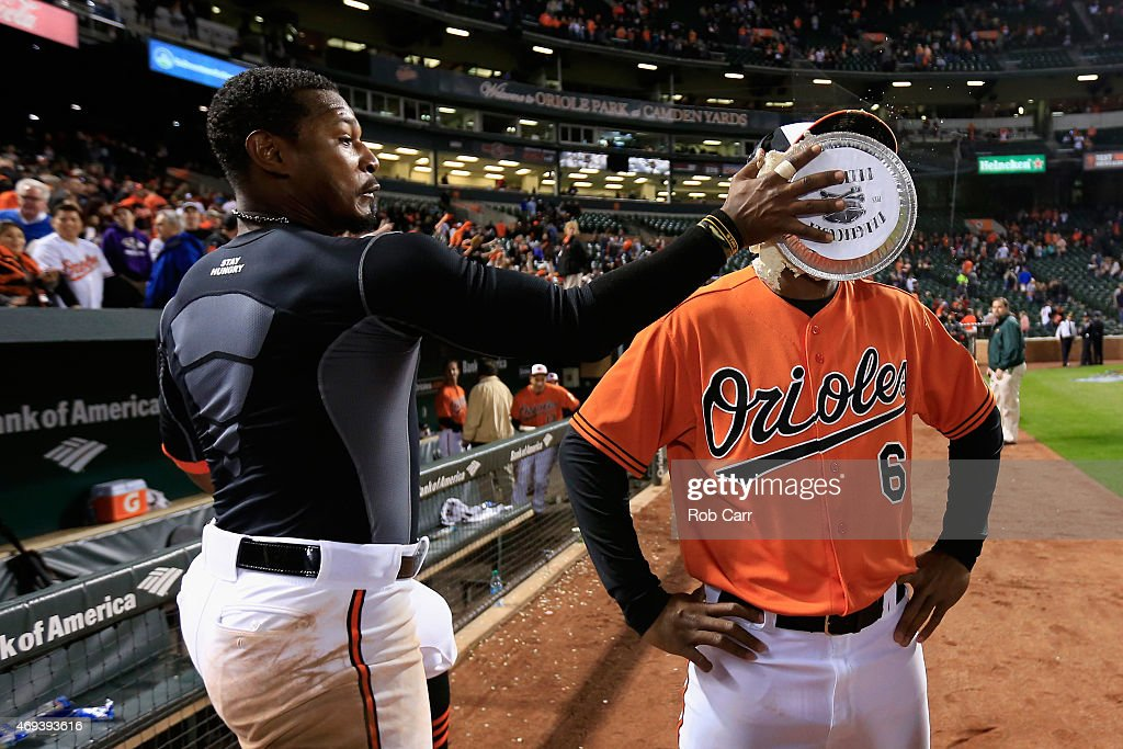 <a gi-track='captionPersonalityLinkClicked' href=/galleries/search?phrase=Adam+Jones+-+Baseball+Player&family=editorial&specificpeople=5460465 ng-click='$event.stopPropagation()'>Adam Jones</a> #10 of the Baltimore Orioles hits teammate <a gi-track='captionPersonalityLinkClicked' href=/galleries/search?phrase=Jonathan+Schoop&family=editorial&specificpeople=2526897 ng-click='$event.stopPropagation()'>Jonathan Schoop</a> #6 in the face with a pie after the Orioles defeated the Toronto Blue Jays 7-1 at Oriole Park at Camden Yards on April 11, 2015 in Baltimore, Maryland.