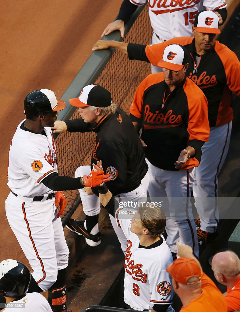 Adam Jones #10 of the Baltimore Orioles in congratulated by teammate <a gi-track='captionPersonalityLinkClicked' href=/galleries/search?phrase=Nate+McLouth&family=editorial&specificpeople=536572 ng-click='$event.stopPropagation()'>Nate McLouth</a> #9 after hitting a solo home run against the Chicago White Sox in the first inning at Oriole Park at Camden Yards on September 5, 2013 in Baltimore, Maryland.