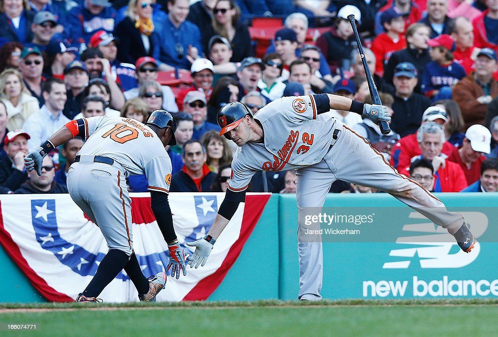 Adam Jones #10 of the Baltimore Orioles is congratulated by teammate <a gi-track='captionPersonalityLinkClicked' href=/galleries/search?phrase=Matt+Wieters&family=editorial&specificpeople=4498276 ng-click='$event.stopPropagation()'>Matt Wieters</a> #32 of the Baltimore Orioles after hitting a solo home run in the ninth inning off of Joel Hanrahan #52 of the Boston Red Sox during the Opening Day game on April 8, 2013 at Fenway Park in Boston, Massachusetts.