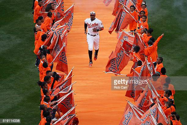 Adam Jones of the Baltimore Orioles is introduced before the start of the Orioles and Minnesota Twins Opening Day game at Oriole Park at Camden Yards...