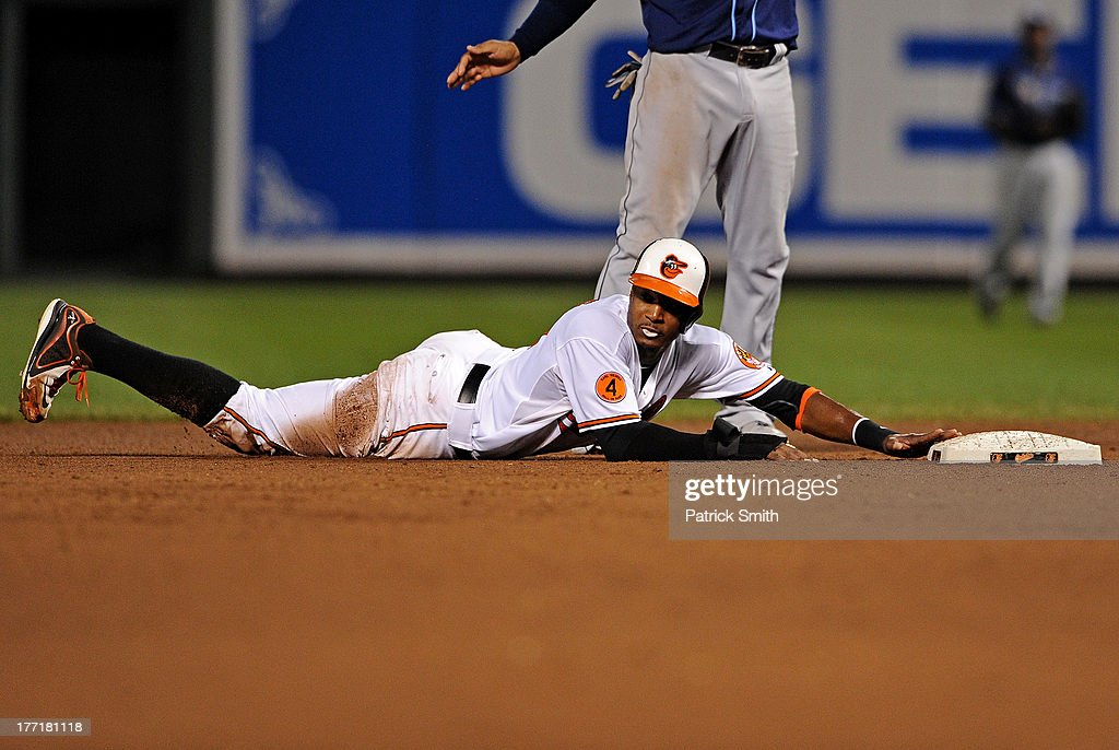 Adam Jones #10 of the Baltimore Orioles looks for the call after being forced out in the fifth inning against the Tampa Bay Rays at Oriole Park at Camden Yards on August 21, 2013 in Baltimore, Maryland. The Baltimore Orioles won, 4-2.
