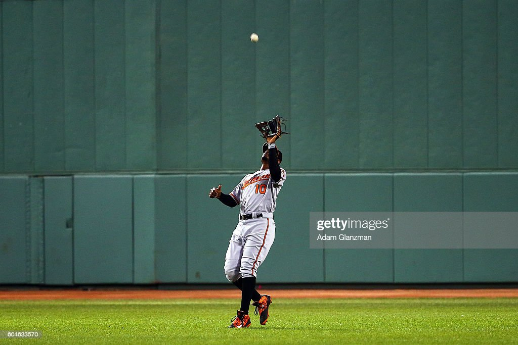 Adam Jones #10 of the Baltimore Orioles makes a catch in the seventh inning of a game against the Boston Red Sox at Fenway Park on September 13, 2016 in Boston, Massachusetts.