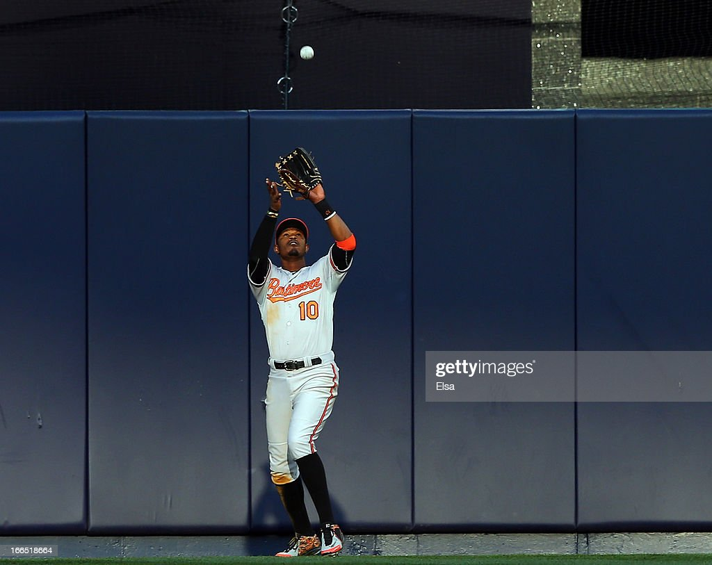 Adam Jones #10 of the Baltimore Orioles makes the catch for the out in the seventh inning against the New York Yankees on April 13, 2013 at Yankee Stadium in the Bronx borough of New York City.The Baltimore Orioles defeated the New York Yankees 5-3.