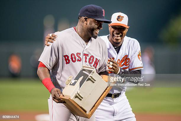 Adam Jones of the Baltimore Orioles presents a replica dugout phone to David Ortiz of the Boston Red Sox during an honorary pre game ceremony for...
