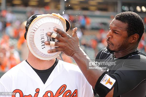 Adam Jones of the Baltimore Orioles puts a pie in the face of Mike Wright of the Baltimore Orioles to celebrate his first major league win in major...