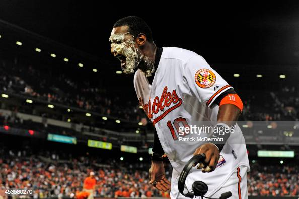 Adam Jones of the Baltimore Orioles reacts after being hit with a pie after the Orioles defeated the New York Yankees 53 during a baseball game at...