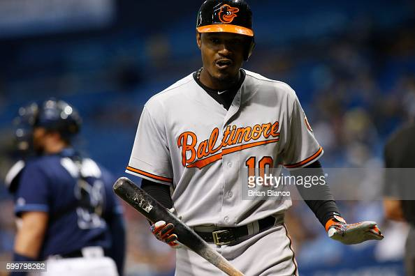 Adam Jones of the Baltimore Orioles reacts after striking out swinging to pitcher Erasmo Ramirez of the Tampa Bay Rays during the sixth inning of a...