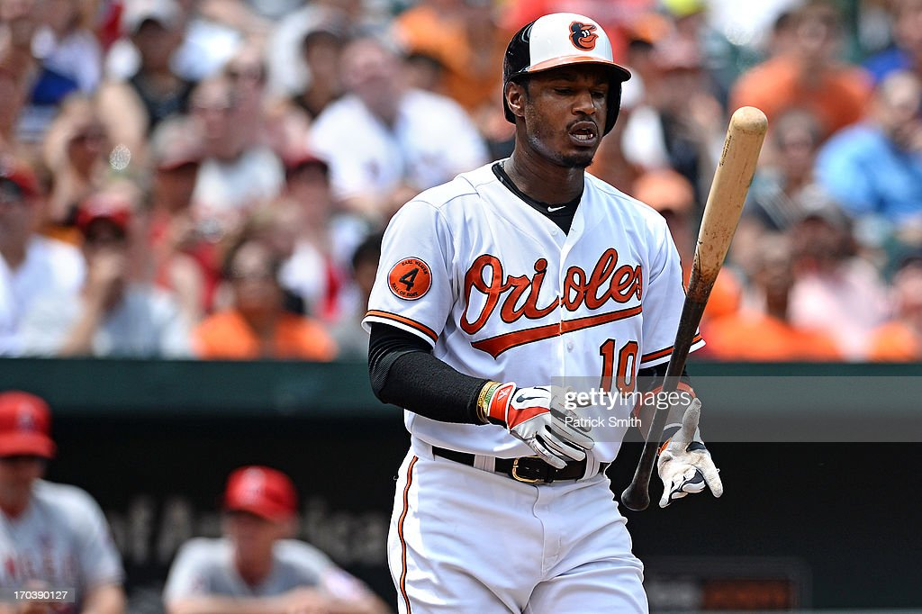 Adam Jones #10 of the Baltimore Orioles reacts after taking a strike in the third inning against the Los Angeles Angels of Anaheim at Oriole Park at Camden Yards on June 12, 2013 in Baltimore, Maryland. The Los Angeles Angels of Anaheim won, 9-5.