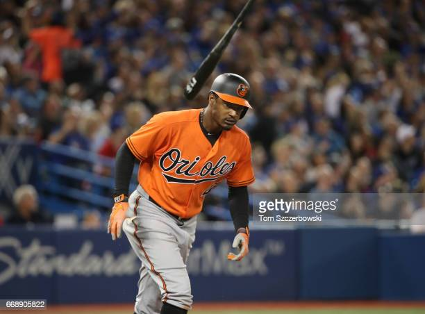 Adam Jones of the Baltimore Orioles reacts as he pops out to end the seventh inning during MLB game action against the Toronto Blue Jays at Rogers...