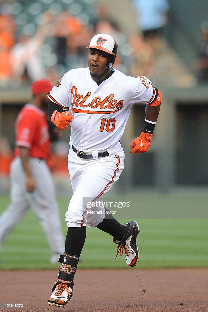 Adam Jones #10 of the Baltimore Orioles rounds second base in the first inning after hitting a two-run home run during a baseball game against the Los Angeles Angels of Anaheim on July 30, 2014 at Oriole Park at Camden Yards in Baltimore, Maryland. The Orioles won 4-3.