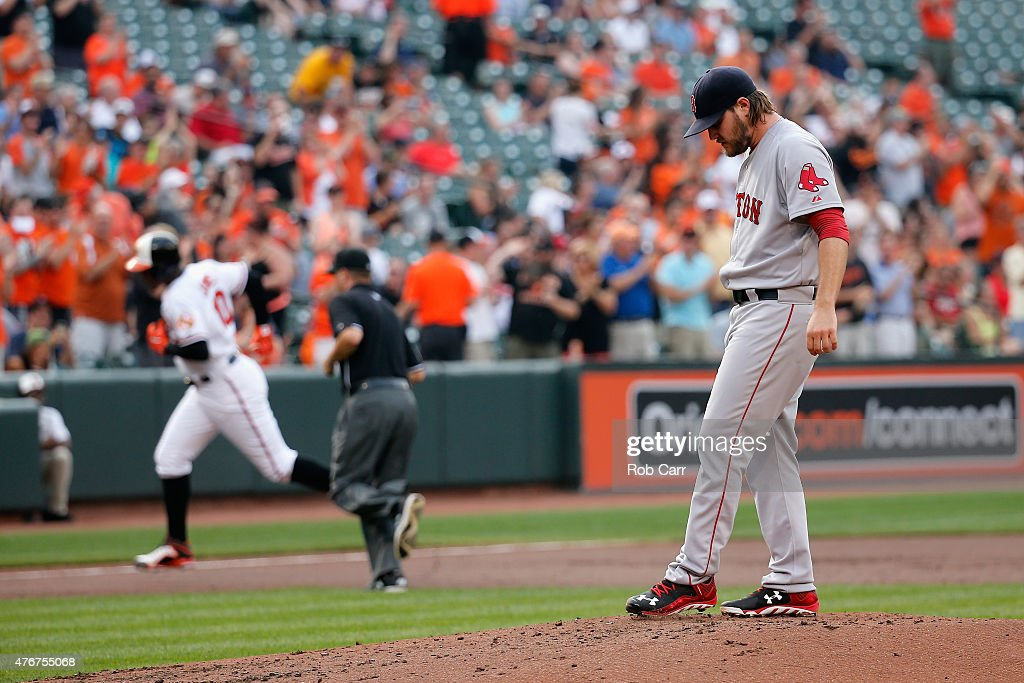 Adam Jones of the Baltimore Orioles rounds the bases after hitting a solo home run off of pitcher Wade Miley of the Boston Red Sox in the first...