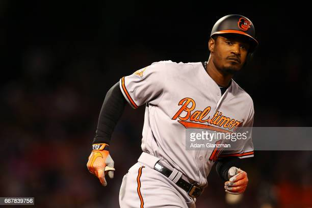 Adam Jones of the Baltimore Orioles rounds the bases after hitting a solo home run in the second inning of a game against the Boston Red Sox at...