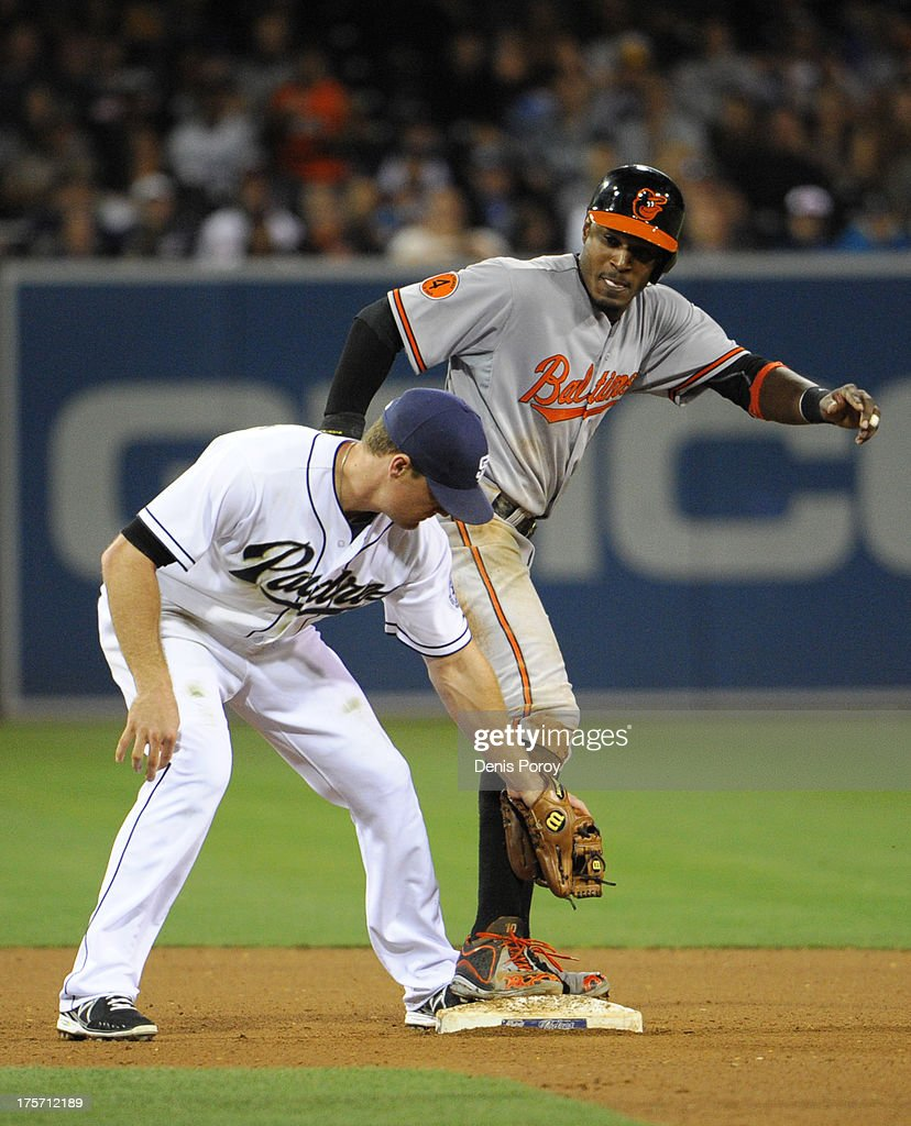 Adam Jones #10 of the Baltimore Orioles steals second base in front of the tag of <a gi-track='captionPersonalityLinkClicked' href=/galleries/search?phrase=Logan+Forsythe&family=editorial&specificpeople=4412508 ng-click='$event.stopPropagation()'>Logan Forsythe</a> #11 of the San Diego Padres during the eighth inning of a baseball game at Petco Park on August 6, 2013 in San Diego, California.