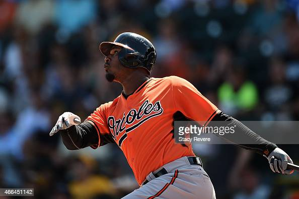 Adam Jones of the Baltimore Orioles swings at a pitch during a spring training game against the Pittsburgh Pirates at McKechnie Field on March 15...