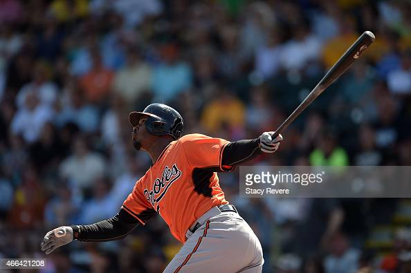 Adam Jones of the Baltimore Orioles swings at a pitch during the first inning of a spring training game against the Pittsburgh Pirates at McKechnie...
