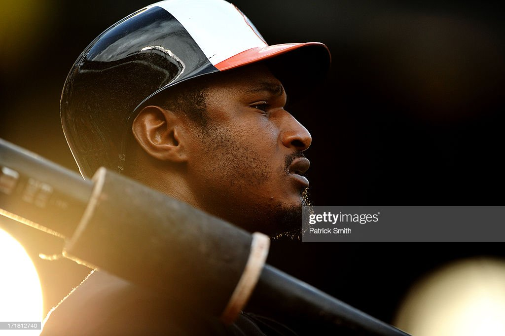 Adam Jones #10 of the Baltimore Orioles waits to bat in the third inning against the New York Yankees at Oriole Park at Camden Yards on June 28, 2013 in Baltimore, Maryland.
