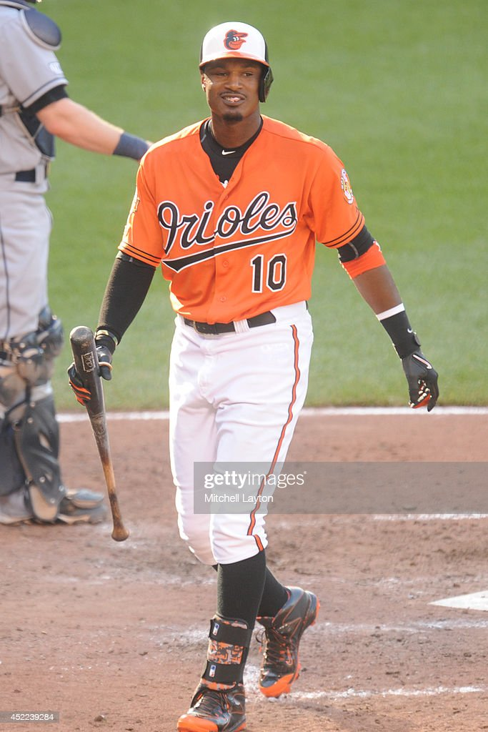 Adam Jones #10 of the Baltimore Orioles walks back to the dug out during a baseball game against the Tampa Bay Rays on June 28, 2014 at Oriole Park at Camden Yards in Baltimore, Maryland. The Rays won 5-4.