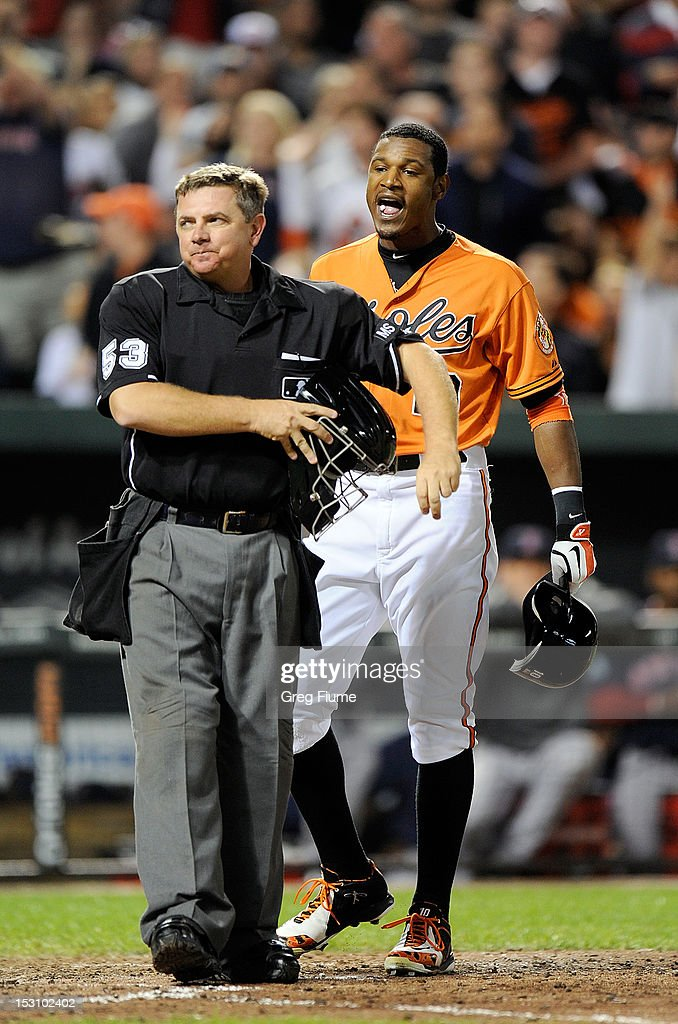 Adam Jones #10 of the Baltimore Orioles yells at home plate umpire <a gi-track='captionPersonalityLinkClicked' href=/galleries/search?phrase=Greg+Gibson&family=editorial&specificpeople=228434 ng-click='$event.stopPropagation()'>Greg Gibson</a> #53 after being called out on strikes to end the seventh inning against the Boston Red Sox at Oriole Park at Camden Yards on September 29, 2012 in Baltimore, Maryland.