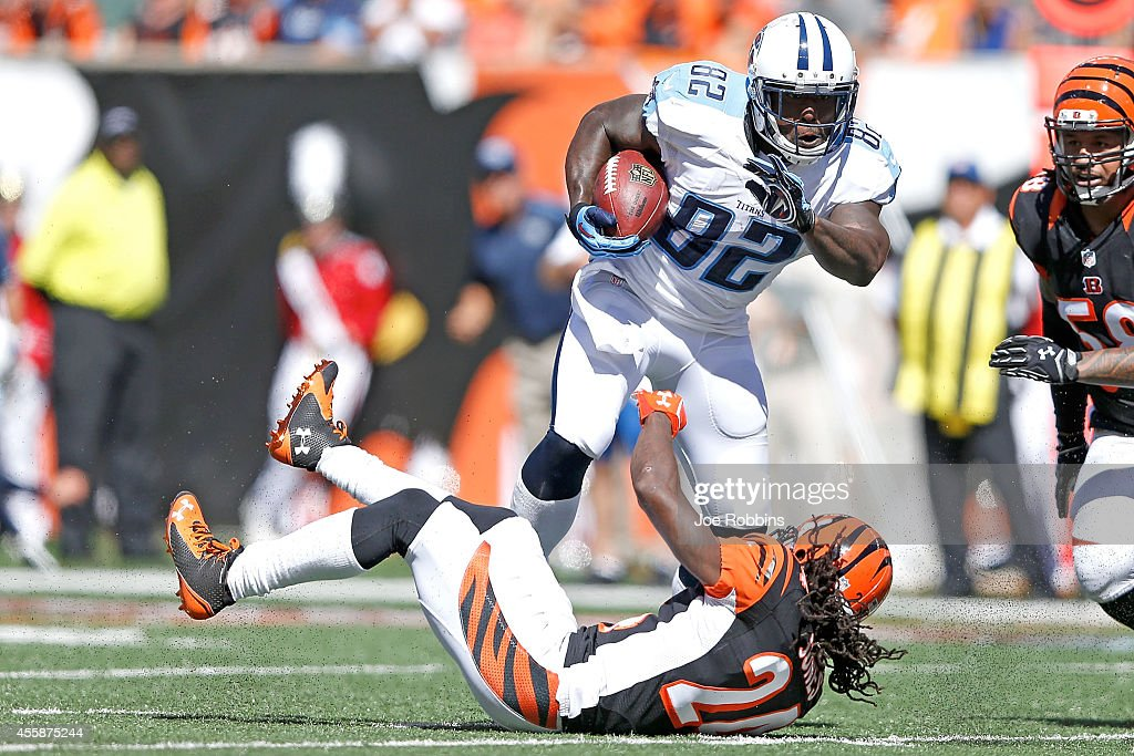Adam Jones of the Cincinnati Bengals is unable to tackle Delanie Walker of the Tennessee Titans during the second quarter at Paul Brown Stadium on...