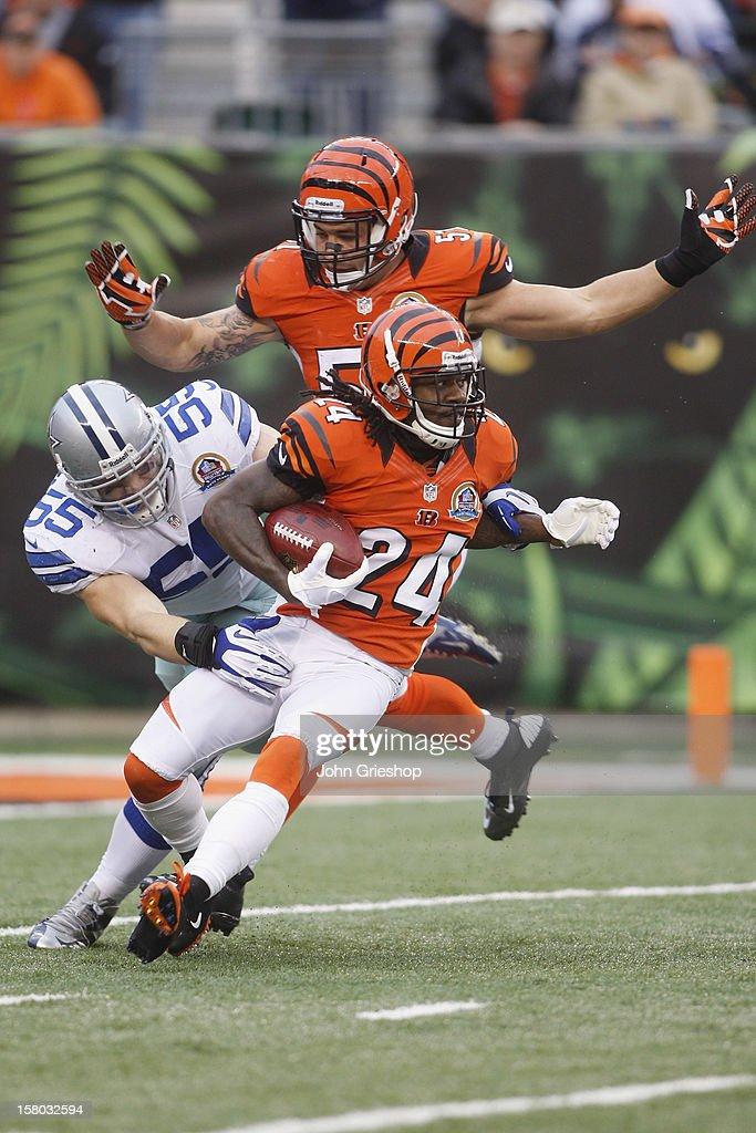 Adam Jones #24 of the Cincinnati Bengals runs the ball upfield against Alex Albright #55 of the Dallas Cowboys during their game at Paul Brown Stadium on December 9, 2012 in Cincinnati, Ohio. The Cowboys defeated the Bengals 20-19.