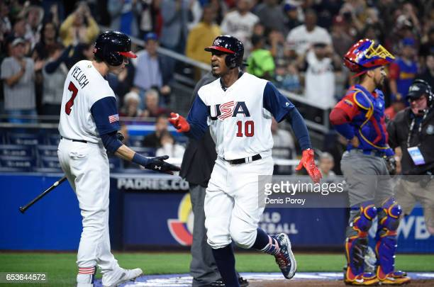 Adam Jones of the United States center celebrates with Christian Yelich after hitting a solo home run in the eighth inning of the World Baseball...
