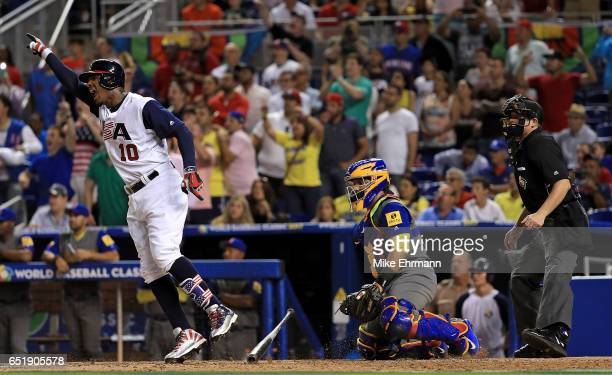 Adam Jones of the United States hits a walk off RBI single in the 10th inning during a Pool C game of the 2017 World Baseball Classic against Comubia...