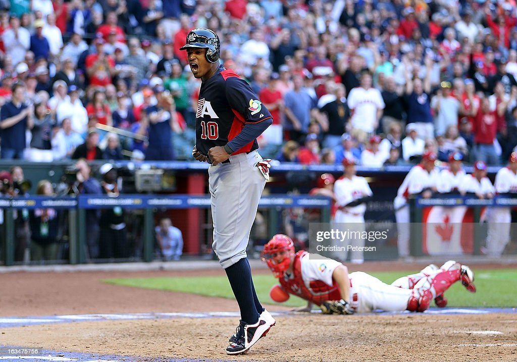 Adam Jones #10 of USA celebrates after scoring a run against Canada during the eighth inning of the World Baseball Classic First Round Group D game at Chase Field on March 10, 2013 in Phoenix, Arizona.