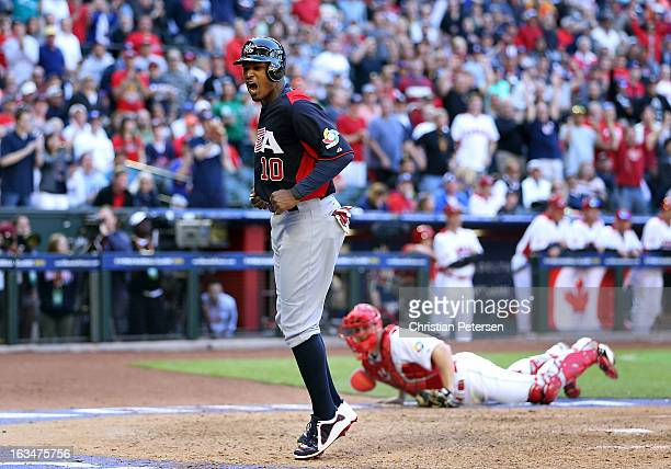 Adam Jones of USA celebrates after scoring a run against Canada during the eighth inning of the World Baseball Classic First Round Group D game at...