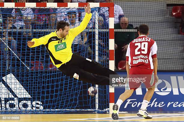 Adam Juhasz of Hungary scores a goal against goalkeeper Silvio Heinevetter of Germany during the 25th IHF Men's World Championship 2017 match between...