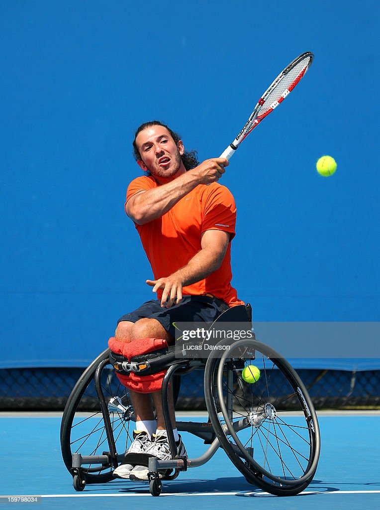 Adam Kellerman of Australia plays a forehand in his match against Ben Weekes of Australia during the 2013 Australian Open Wheelchair Tennis Wildcard playoff at Melbourne Park on January 21, 2013 in Melbourne, Australia.