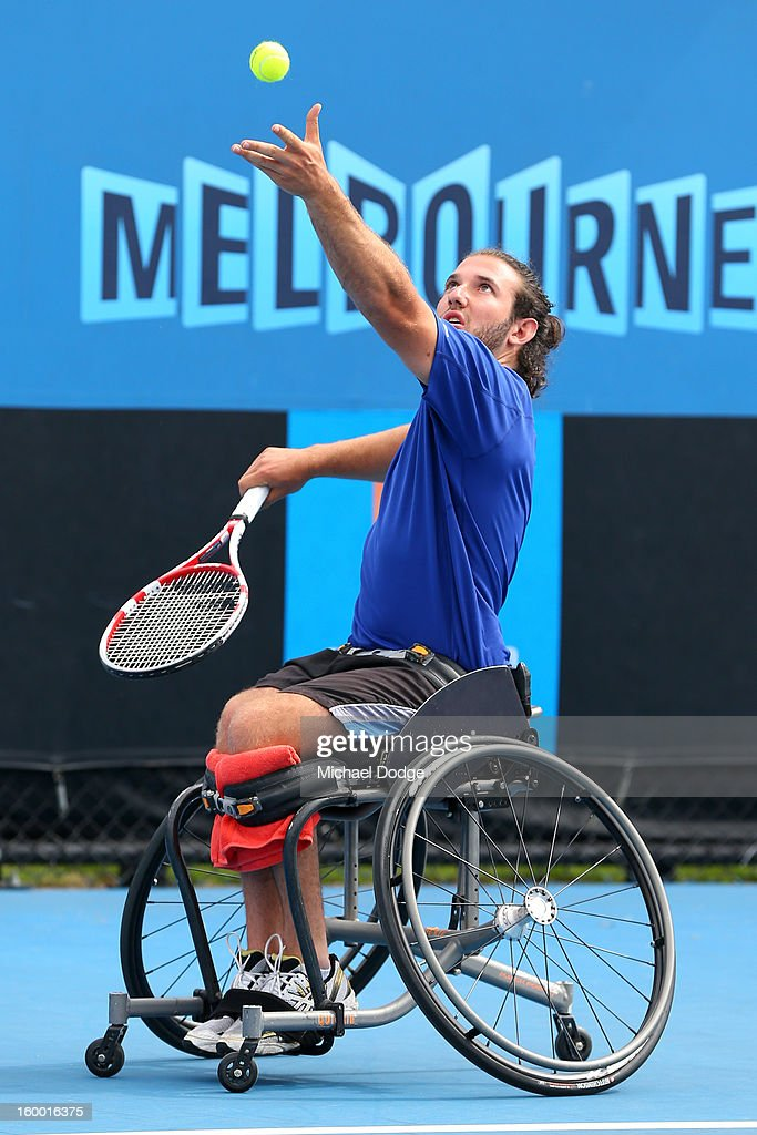Adam Kellerman of Australia plays a shot in his Wheelchair Doubles Final with Stefan Olsson of Sweden against Michael Jeremiasz of France and Shingo Kunieda of Japan at Melbourne Park on January 25, 2013 in Melbourne, Australia.