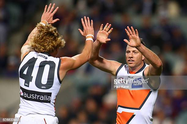 Adam Kennedy and Steve Johnson of the Giants celebrate a goal during the round seven AFL match between the Fremantle Dockers and the Greater Western...