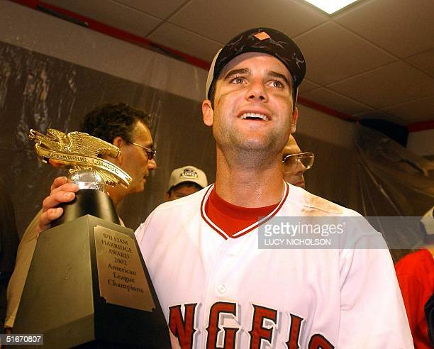 Adam Kennedy of the Anaheim Angels who hit three home runs holds the American League Champions trophy after the Angels defeated the Minnesota Twins...