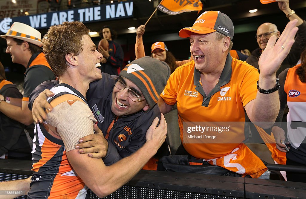 Adam Kennedy of the Giants celebrates the win with fans during the round seven AFL match between the Carlton Blues and the Greater Western Sydney...