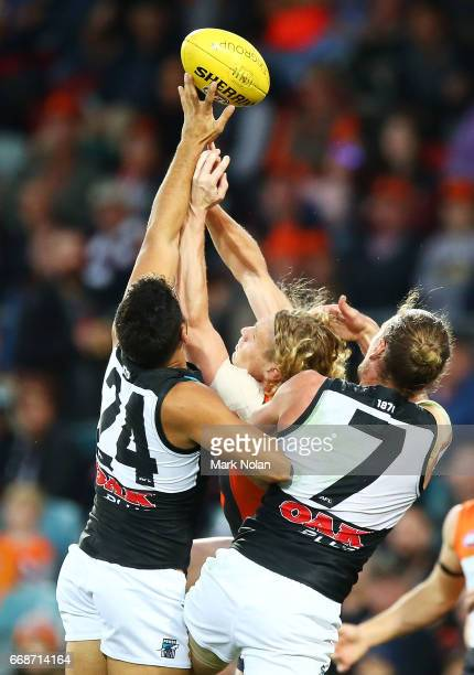 Adam Kennedy of the Giants contests a mark against Jarman Impey and Brad Ebert of the Power during the round four AFL match between the Greater...
