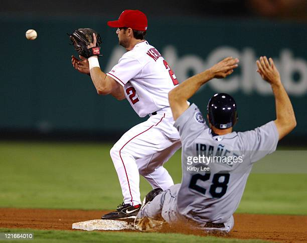 Adam Kennedy of the Los Angeles Angels of Anaheim retires Raul Ibanez of the Seattle Mariners in a force out at second base in the ninth inning of 63...