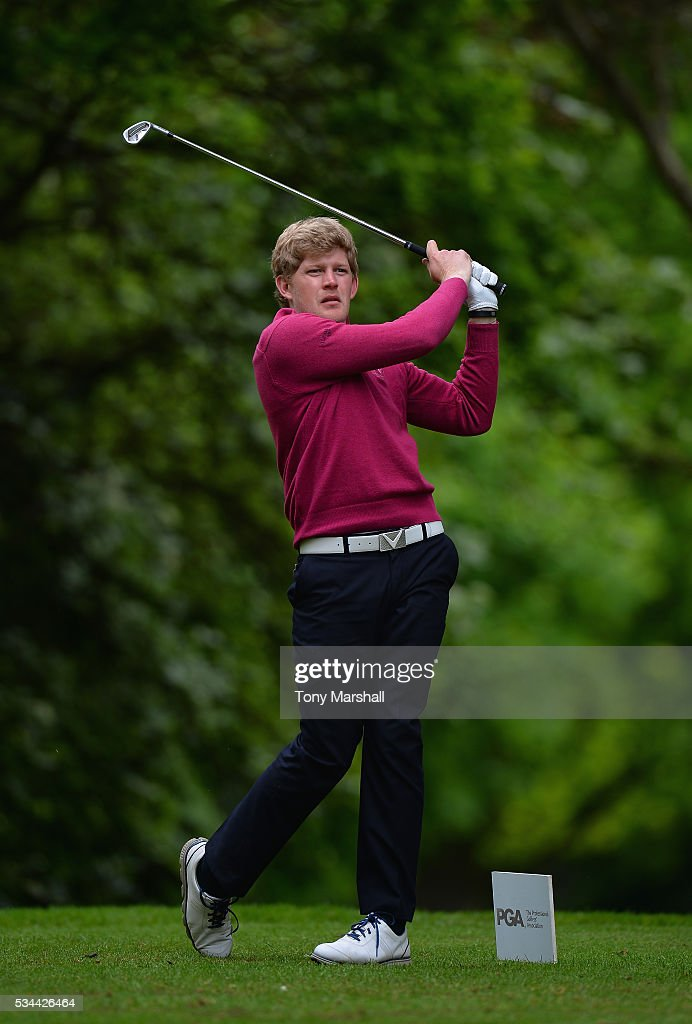 Adam Keogh of Spalding Golf Club plays his first shot on the 17th tee during the PGA Assistants Championships - Midlands Qualifier at the Coventry Golf Club on May 26, 2016 in Coventry, England.