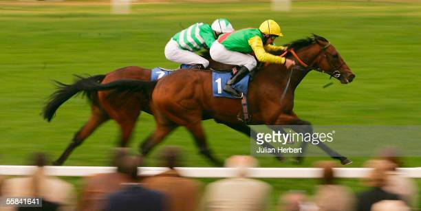 Adam Kirby and Fairmile get the better of the Liam Keniry ridden Breathing Fire to land The betfredpokercom Handicap Race run at Windsor Racecourse...