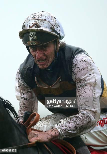 Adam Kirby jockey of Mannaro finishes The bet365 Handicap mud splattered